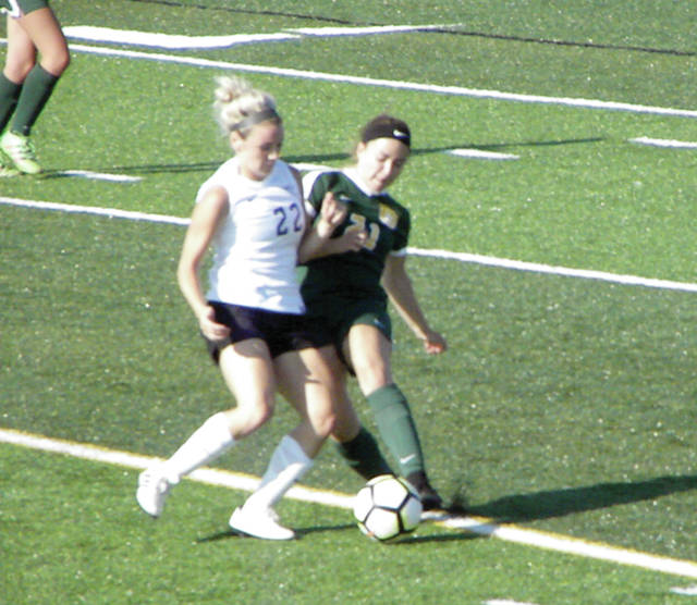 Bridget Harlett of Swanton, left, fights for a loose ball in a game versus Evergreen this season. Both her and Morgan Pine were named first team All-NWOAL for the Bulldogs.