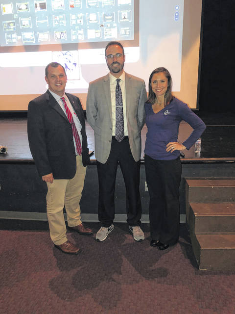 Scott Grant, pictured with Swanton High School principal Jason Longbrake, far left, and SACC executive director Andrea Smith, was in Swanton to talk to students about social media.