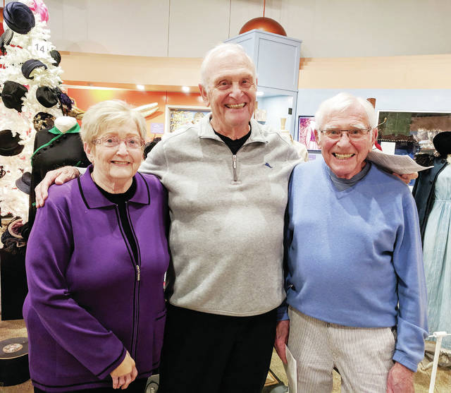 """Kay Meuth, Phil Roos, and Jim Roos, nieces and nephews of Claire and Louise Jones, visit the """"Keeping Up With the Joneses"""" exhibit at the Museum of Fulton County."""