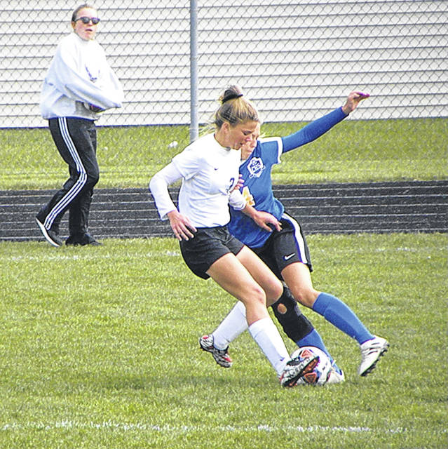 Swanton's Macy Pawlowicz steps in front of a Continental player for a ball during Saturday's sectional final. The Bulldogs edged the Pirates 2-1.
