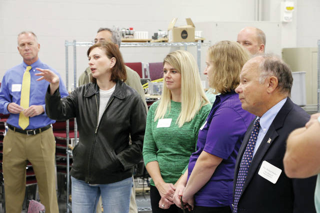 Amy Merrill-Wyatt, Springfield Local Schools middle schools career teacher, asks a question during a recent tour of the Advanced Manufacturing Training Center in Toledo. State Representatives Michael Sheehy (far right) and Teresa Fedor were also in attendance.