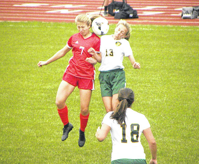 Amanda Wendt of Wauseon (7) and Sydney Woodring of Evergreen (13) go up for a header Thursday in NWOAL girls soccer. The Vikings won by a final of 6-0.