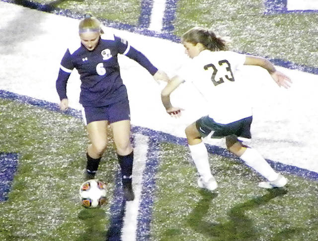 Callie Benner of Evergreen, right, looks to challenge Addison Moyer of Archbold for a ball Wednesday in a girls soccer district semifinal. However, the Bluestreaks would defeat the Vikings 4-1.