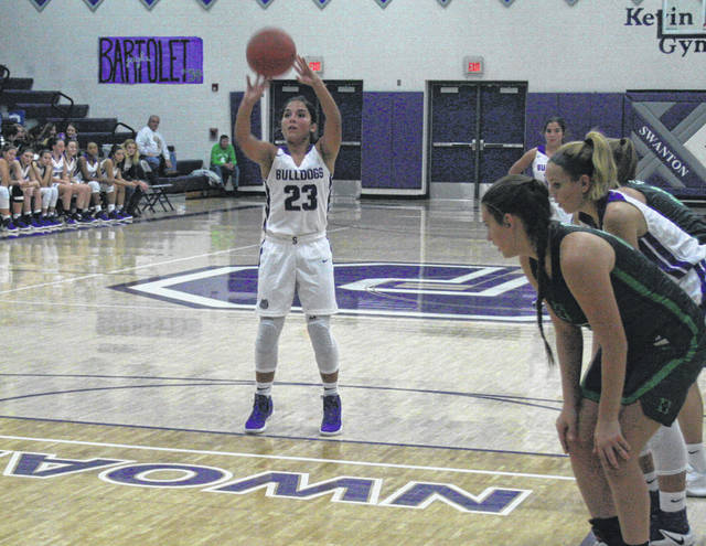 Averie Lutz of Swanton splits a pair from the foul line in Friday's loss to Delta. The Bulldogs return to action tonight when they host Lake.