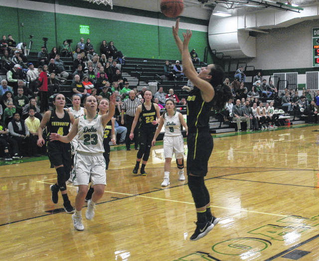 Kelsie Komisarek of Evergreen makes a basket versus Delta last season. She also returns for the Vikings this season.