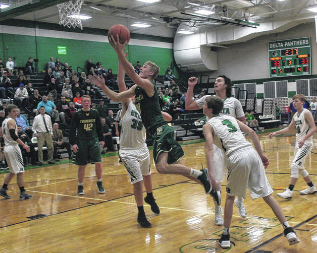 Chandler Lumbrezer lays one in for Evergreen versus Delta last season. He averaged just over seven points per game in his junior season.