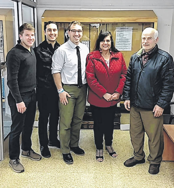 Nat Dick, Peace Corps representative; Dominic Shamas of US Together; Kevin Heintschel, Swanton Middle School Intervention Specialist; Corine Dehabey, Director of US Together Toledo; and Ahmad Tahhan, Syrian refugee at the middle school on Wednesday.