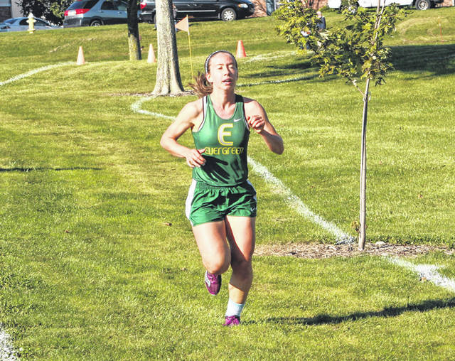 Evergreen's Sarah Schwan runs at a meet earlier this season. This past Saturday at the state meet, she took 41st in the Division III girls race.