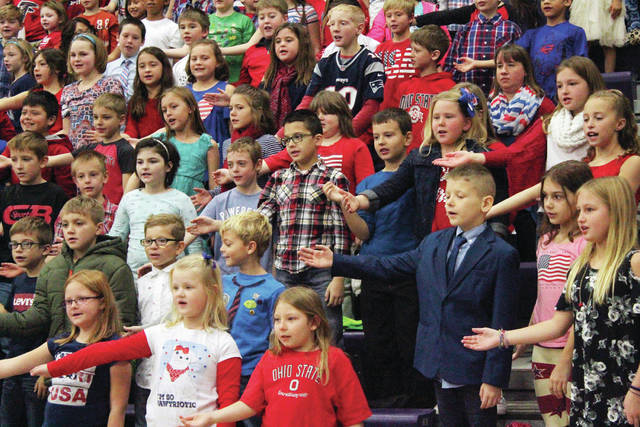 "Swanton Elementary School students sing ""Heart of America"" during the Veterans Day program on Friday."
