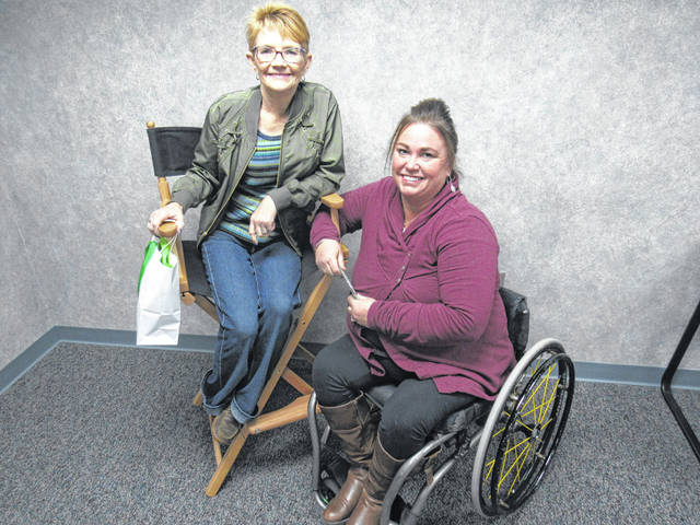 Trish Andre, left, was recognized for 15 years as a 4-H advisor and Jen Ruetz was recognized for 10 years.