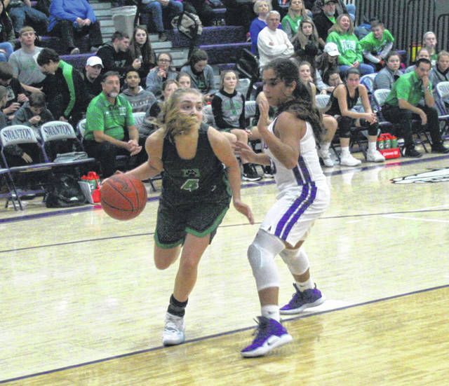 Swanton's Averie Lutz, right, defends Braelyn Wymer of Delta during the Bulldogs' first game this season. On Thursday, the Dogs got their first win when they defeated Ottawa Hills 37-25.