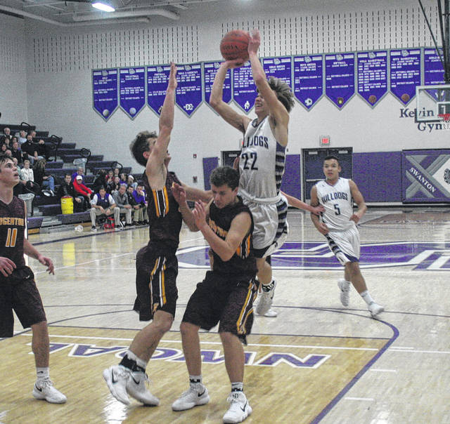 Swanton's Dylan Gilsdorf draws a foul during a game last season. There are changes coming to the OHSAA boys basketball state tournament beginning in 2019. State semifinals will now be doubleheader sessions.