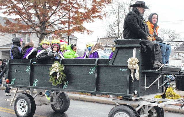 The Christmas in Swanton princes and princesses ride in the parade Saturday morning.