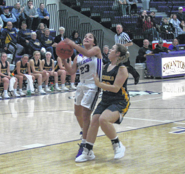 Averie Lutz of Swanton scores on a fastbreak Friday against Archbold. She led all scorers with 16 points, however, the Bulldogs fell to the Blue Streaks 45-34.