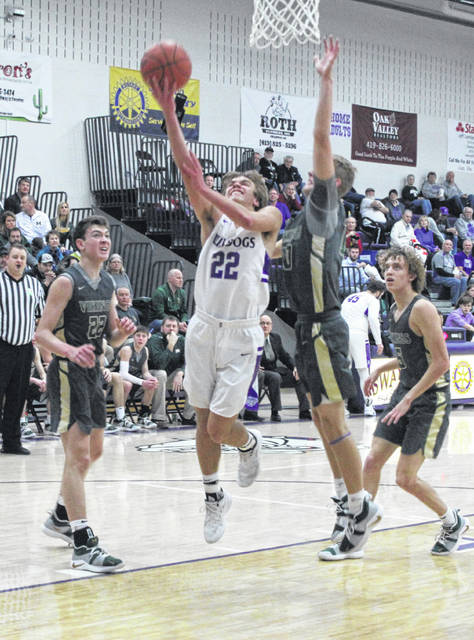 Dylan Gilsdorf of Swanton drives to the basket for two points against Evergreen on Friday.