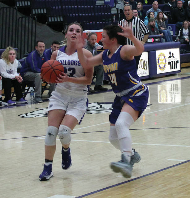 Swanton senior Bridget Harlett drives to the bucket against Bryan on Friday.