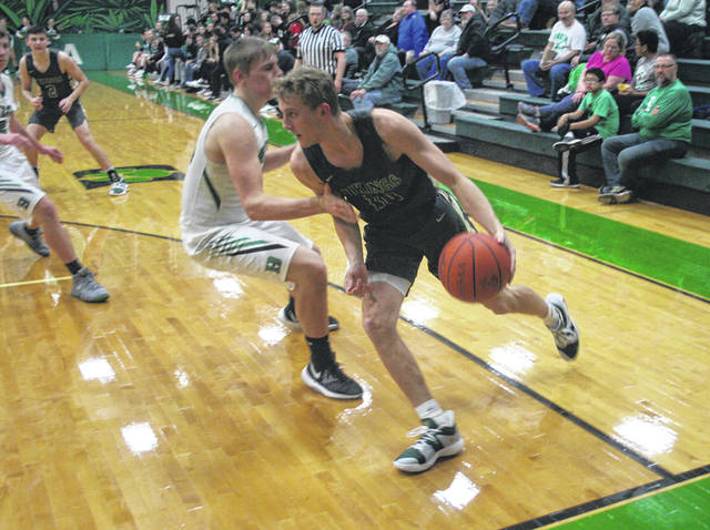 Chandler Lumbrezer of Evergreen drives around Hunter Tresnan-Reighard of Delta during Friday's NWOAL boys basketball contest. The Vikings moved to 3-0 in the league with a 46-25 win over the Panthers.