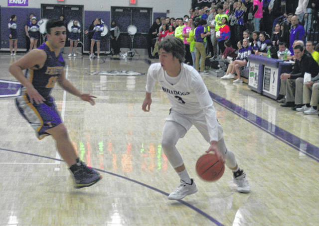 Josh Vance of Swanton drives to the hoop Tuesday versus Fayette. The Bulldogs fell in overtime to the Eagles, 45-40.