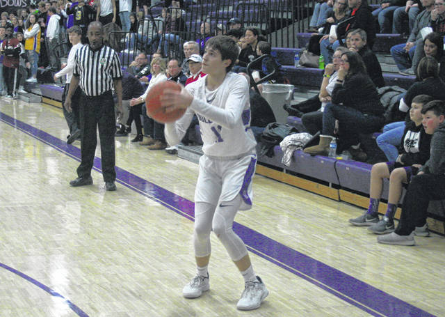 Jared Wilson of Swanton fires up a shot from long range Saturday versus Otsego in non-league boys basketball. He paced the Bulldogs with 10 points as they fell to the Knights, 49-38.