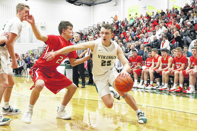 Nic Borojevich of Evergreen drives around a Wauseon defender during Friday night's NWOAL contest. The Vikings fell convincingly to the Indians, but bounced back for an overtime victory over Fayette on Saturday.