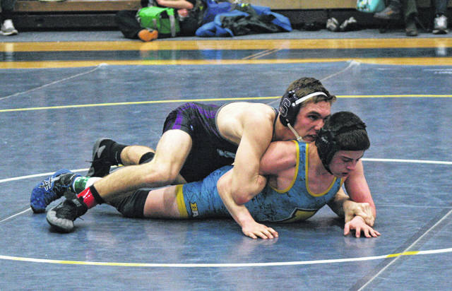 Ryan Marvin of Swanton, top, on Friday in the Division III sectional wrestling tournament at Archbold. He went on to win the sectional title at 152 pounds, besting Tyler Kay of Liberty Center 3-1.