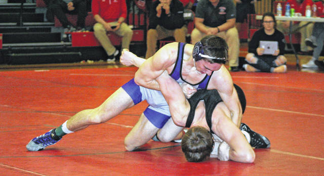 Ryan Marvin of Swanton, top, takes control in the 152-pound final against Tyler Kay of Liberty Center. However, Marvin would fall to Kay in overtime, 5-3.