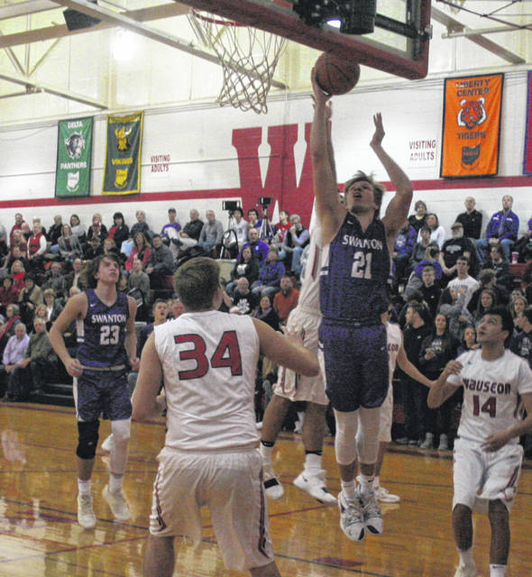 Randy Slink of Swanton gets inside for a layup versus Wauseon Friday night. He finished with 11 points in that contest, then scored 12 in the Bulldogs' 45-28 win over Lake on Saturday.