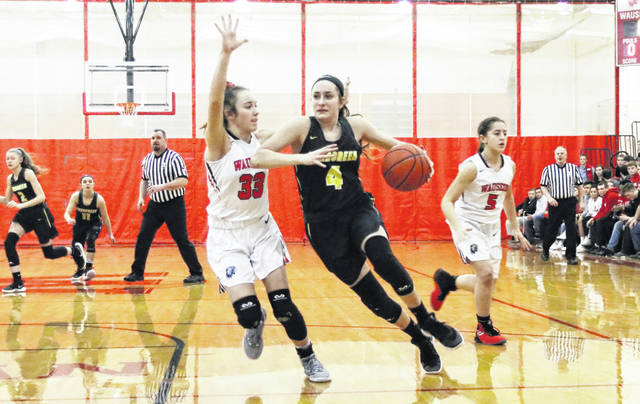 Savannah VanOstrand of Evergreen (4) works the ball up the court as Sam Aeschliman defends for Wauseon. The Vikings fell to the Indians Thursday, then defeated Fayette two days later 53-49.