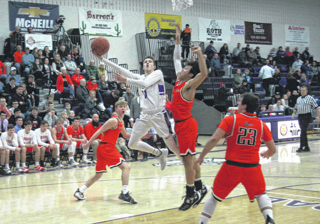 Jared Wilson of Swanton puts up an off-balance shot versus Liberty Center Friday night in NWOAL boy basketball. The Bulldogs earned their second league win of the season, downing the Tigers 44-42.