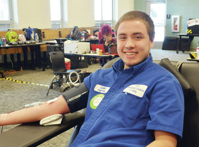 Four County Career Center students in Archbold recently donated blood during the HOSA Future Health Professionals sponsored Red Cross blood drive. HOSA members planned and coordinated the drive and students assisted with donor registration, testing, and blood donations. Shown is Collin Harris of Delta. HOSA Advisor Robin Hill, Health Careers instructor, coordinated the event.