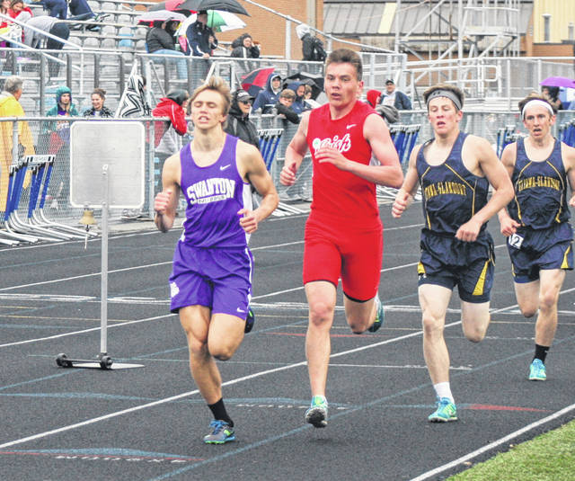 Swanton's Dylan Gilsdorf, far left, in the 1600 meter run at the Division II district meet last season. He is back for his senior season in 2019.