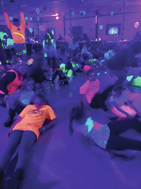 Family fun under black lights at last year's Glow Party.