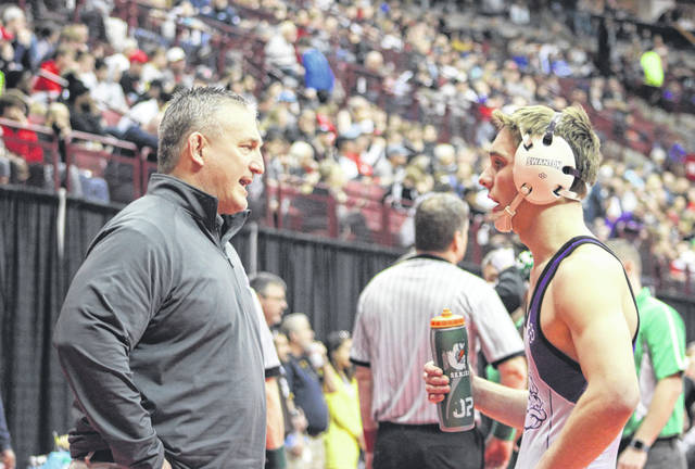 Swanton's Ryan Marvin, right, receives instruction during a stoppage in the 152-pound fifth place match Saturday at the State Wrestling Tournament in Columbus. He would take fifth for the Bulldogs, moving up three places from a year ago when he finished eighth at 160 pounds.