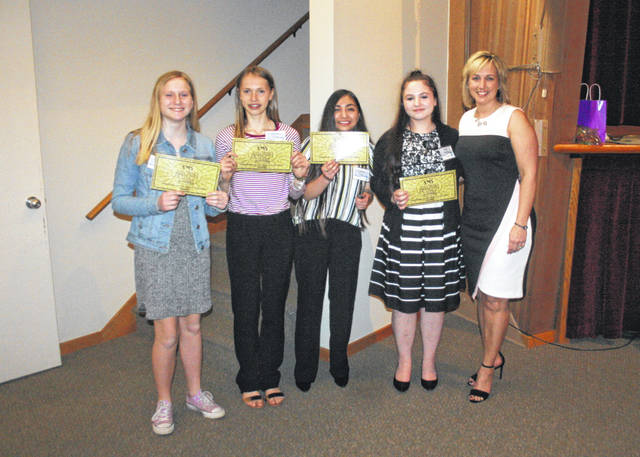 The top four contestants of Swanton Middle School's Amazing Shake competition were recognized for their achievement at the Fulton County Economic Development Corporation Annual Meeting Thursday in Archbold. They are, from left: Makaila Levin, Sapientia House; Emma Crow, Dignitas House; Sydney Ruiz, Obduro House; and Kalila Shanly, Gratus House. Standing with them was Jessica Double of Worthington Industries, where the recent round of competition was held.