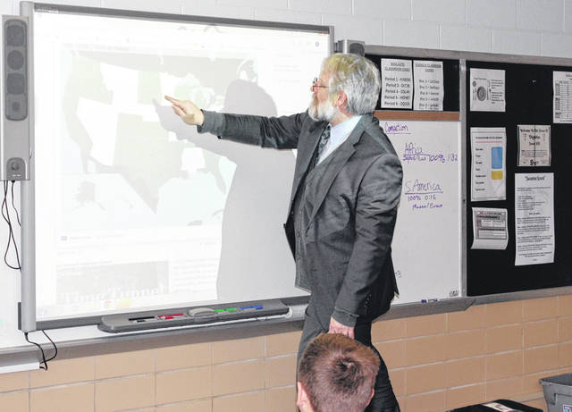 Ohio Superintendent of Public Instruction Paolo DeMaria competed against Swanton sixth grader Logan Young in identifying the 50 states during his visit to Swanton Middle School Friday.