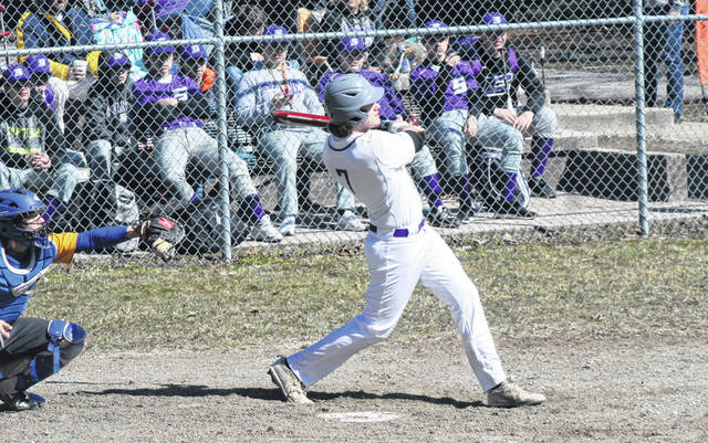Roman Epley of Swanton belts one to left field in the season opener March 23 against Northwood. Last Monday, Epley picked up the win on the mound in the Bulldogs' 10-0 win over Evergreen. He also drove in a pair of runs.