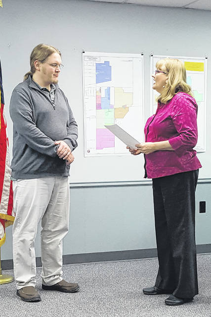 Swanton Public Library Director Adam Walter is in attendance as Swanton Mayor Ann Roth reads a proclamation for National Library Week during last week's council meeting.
