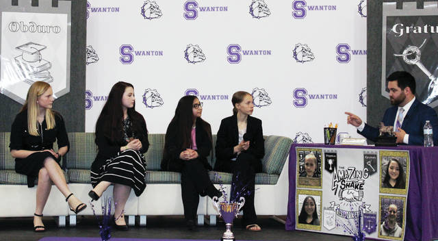 Mika Levin, Kalila Shanly, Sydney Ruiz, and Emma Crow answer a final round of questions from Jordan Strack, WTOL Sports Director, at the Amazing Shake finale at Swanton Middle School.