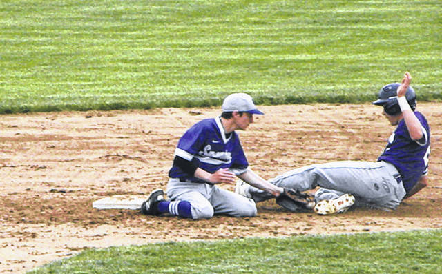 Tommy Chonko of Swanton tags out a Bryan base stealer Friday in a Division III sectional final. The Bulldogs fell to the Golden Bears, 5-1.