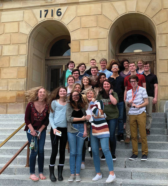 Swanton students stand in front of the Federal Courthouse in Toledo on a windy day.