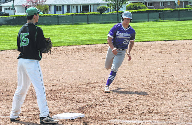 Swanton's Michael Lawniczak heads to third on a Derek Floyd single during Saturday's game at Ottawa Hills. The Bulldogs earned wins over Wauseon and Cardinal Stritch Wednesday and Friday, before falling to the Green Bears Saturday.