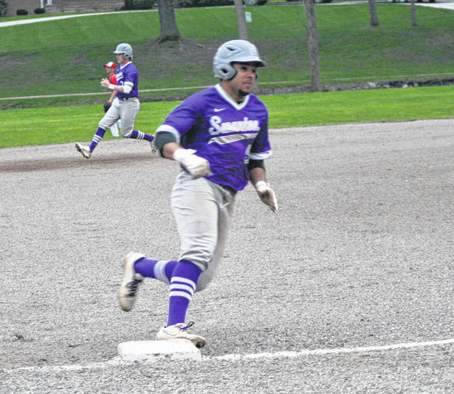 Hunter Mix rounds third and scores for Swanton in the second game versus Patrick Henry Friday. The Bulldogs defeated the Patriots 7-4 both in the completion of a suspended NWOAL game from April 18, then in a five-inning non-league contest.