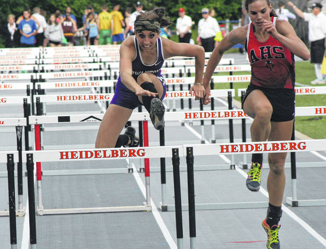Swanton's Bobbie Oberle competes in the 100m hurdles during the finals of the Division III Tiffin Regional held at Heidelberg University Friday. Oberle advanced with a fourth place finish.