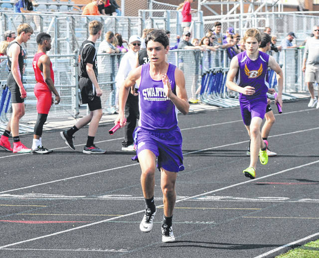 Blaine Pawlowicz of Swanton runs the third leg of the boys 4x800 meter relay Wednesday during day one of a Division II district track meet at Defiance. Swanton would qualify for the Piqua Regional, taking third with a time of 8:32.85.