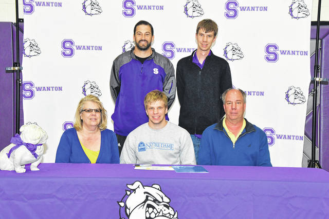 Swanton's Randy Slink signed his letter of intent Wednesday to further his basketball and education career at Notre Dame College in South Euclid, Ohio. Front row, from left: Mary Slink (mother), Randy, Bill Slink (father). Back row: Swanton varsity basketball coach Joel Visser, Eric Slink (brother).