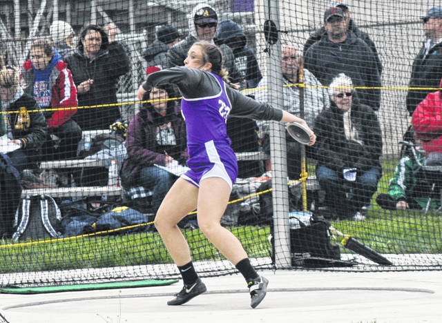 Sammi Taylor of Swanton fires a disc in the girls discus Tuesday, May 7 during day one of the NWOAL Track and Field Championships. She placed third with a best throw of 113 feet, 7 inches.