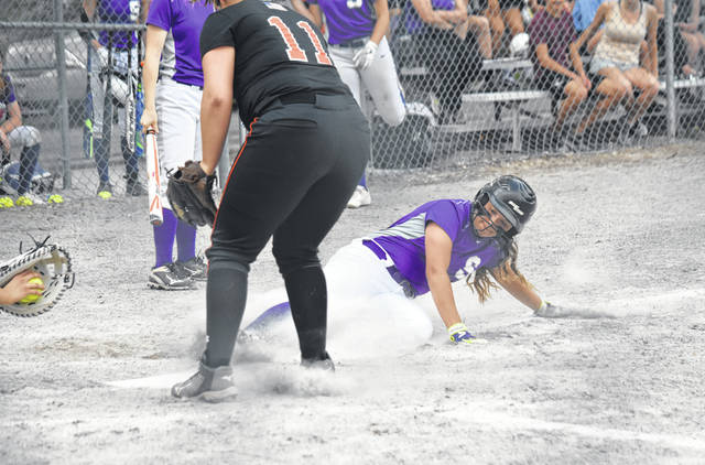 Kylie Ulch of Swanton slides in safely on a wild pitch as part of the Bulldogs' seven-run fourth inning during a Division III sectional semifinal against Liberty Center Monday. Swanton would advance with an 8-6 triumph over the Tigers.