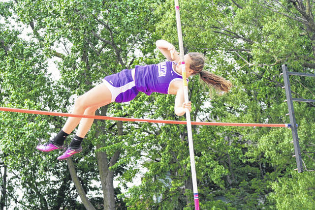 Hannah Grabke of Swanton clears the bar in the girls pole vault at the Division III regional meet Friday, May 24. She received an at-large bid to the state meet, tying for 10th.