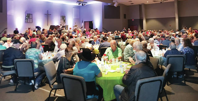 """The Fulton County Senior Center hosted a """"Summertime Bash"""" for 350 Fulton County seniors June 7 at Pettisville Missonary Church. The seniors enjoyed a chicken BBQ lunch and were treated to musical entertainment by local band Linden Street. Pettisville honor students helped to serve the meal."""