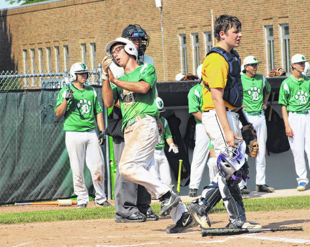 Delta's Chase Cooper celebrates scoring the game's first run.